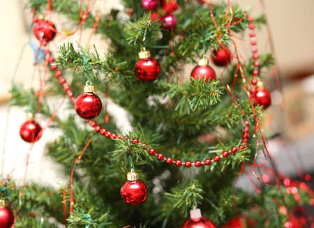 christmastide: decorations with red glass balls decorate a Christmas tree