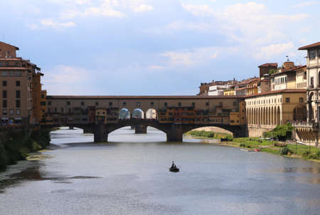 ponte vecchio: old Bridge called Ponte Vecchio in Florence Italy and a boat in arno river