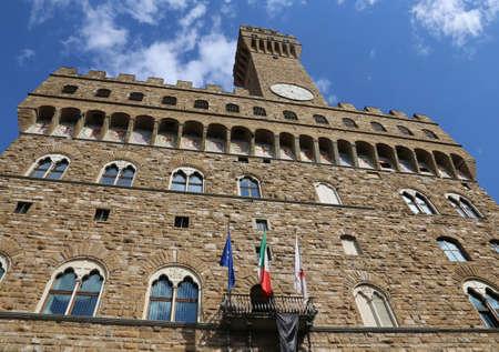 signoria square: Florence Italy Historic clock tower building called Palazzo Vecchio in the Signoria square Stock Photo