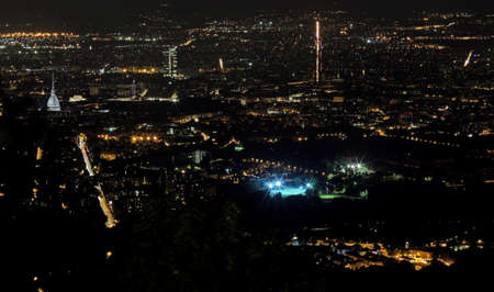 demografia: night aerial view of the populous European metropolis with many city lights Foto de archivo