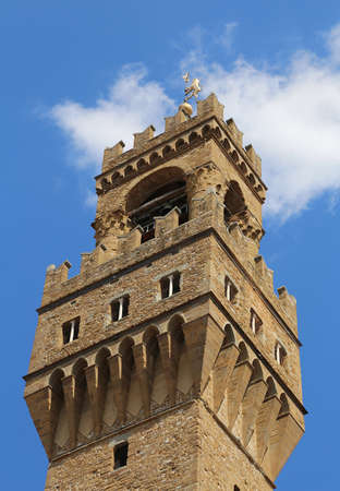 signoria square: Detail of Old Palace Tower called Palazzo Vecchio in Florence Italy Editorial