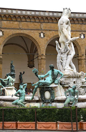 signoria square: Florence historical fountain with the statue of Neptune in the main square Editorial