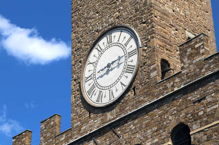 signoria square: Detail of Ancient Clock Tower of Old Palace called Palazzo Vecchio in Florence Italy