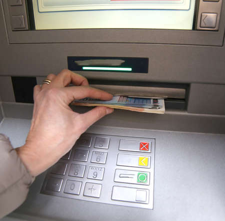withdrawal: withdrawal of money in European banknotes from automatic cash machine Stock Photo