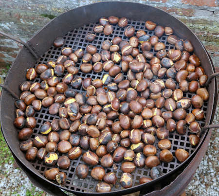 street vendor: chestnuts roasted on the fire from a street vendor on the road in winter Stock Photo
