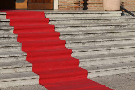 privileged: long red carpet for the catwalk of celebrities along the staircase