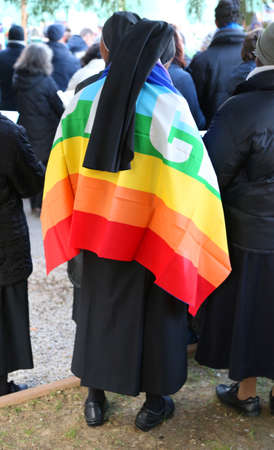 pace: Vicenza (VI) Italy. 1st January 2016. Peace March one African nun with flag with the word PACE peace in Italian Editorial