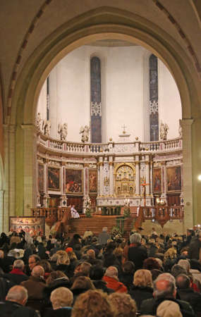 priesthood: Vicenza (VI) Italy. 12 December 2015. Inside the cathedral with many worshipers during Mass for the opening of the Holy Door Editorial