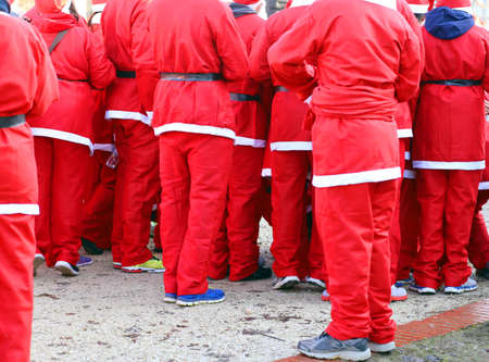 red pants: red pants of people dressed as Santa Claus during the race in the city Stock Photo