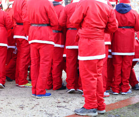 red pants: red pants of people dressed as Santa Claus during the foot race in the city