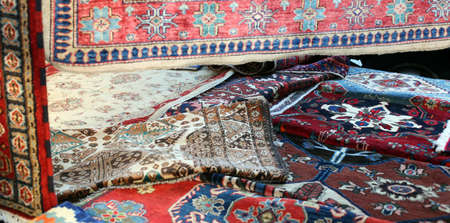 wool rugs: many precious ancient colored wool rugs made by hand in the Middle East