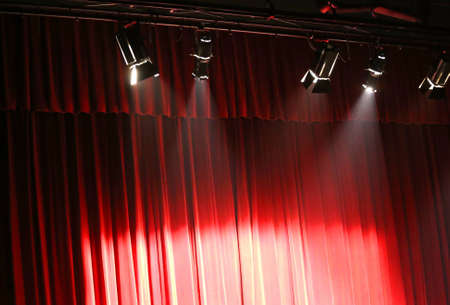 lighting system: red theater curtain over the stage and the lights overhead projectors