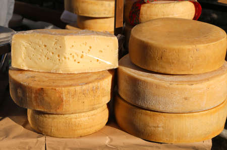 hard sell: tasty mature cheese with holes for sale in the market of food Stock Photo