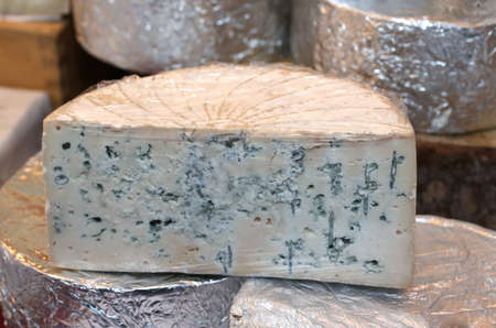 penicillium: smelly Gorgonzola cheese typical of northern Italy on sale in the market Stock Photo