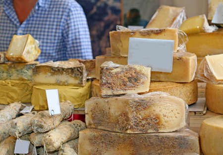 seasoned: much old moldy cheese and very seasoned for sale at the market