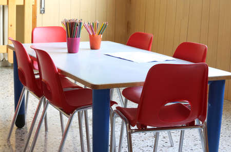 scholastic: inside kindergarten with pencils and small red chairs