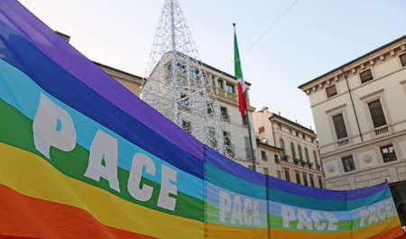 activists: rainbow peace flag during a demonstration of peace activists in Italy