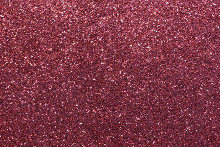 gaudy: red background with glitter very shimmering under the bright light Stock Photo