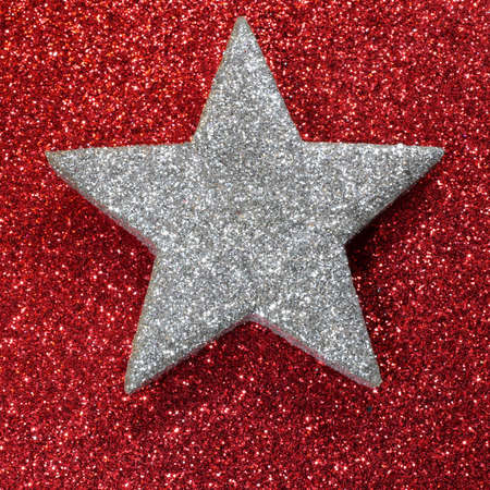 red star: glitter silver star red background Stock Photo