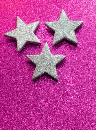 silver stars: large silver stars on bright purple glittery illuminated background