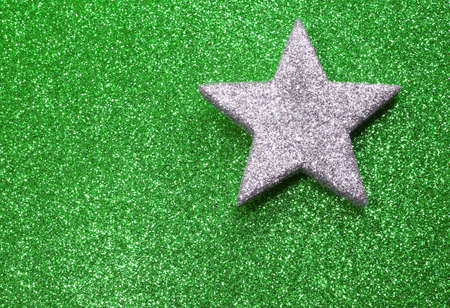 silver star: great silver star in brilliant green background Stock Photo