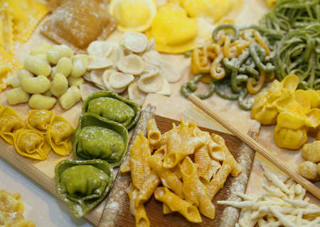 coeliac: green and yellow tortellini homemade with eggs and flour  and fresh spinach