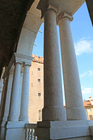 torment: Vicenza, medieval tower called Tower of torment in the historic Italian city and basilica palladiana Editorial