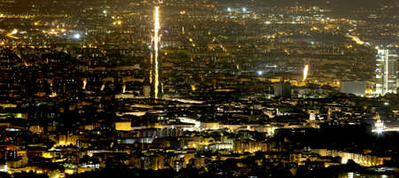 demografia: night aerial view of the populous metropolis with many city lights