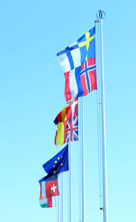 onu: many flags of many nations in the wind on a sunny day with blue sky Stock Photo