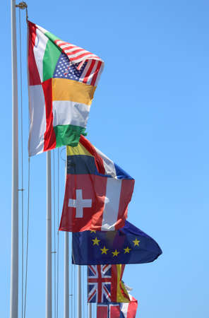 onu: flags of many nations in the wind on a sunny day with blue sky