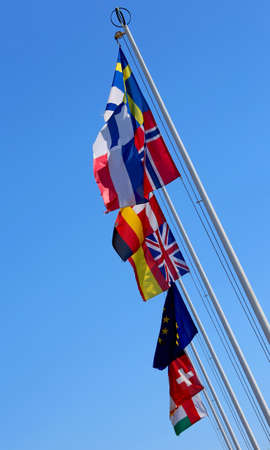 onu: many flags of many nations world waving in the blue sky Stock Photo
