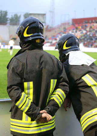 hardhat: two firefighters with hardhat during the sports event at the stadium
