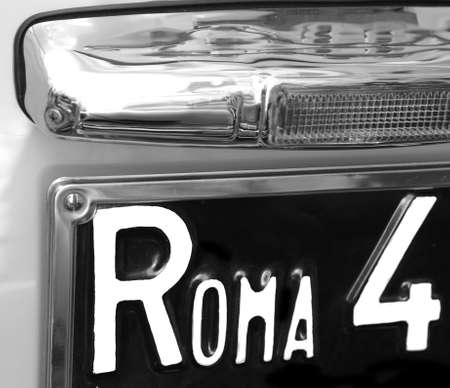 number plate: ROME big writing on the car number plate of a car Italian
