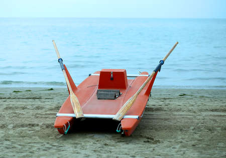 bather: rescue boat rowing for lifeguard on the shore of the sea Stock Photo