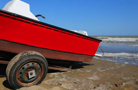 bather: Red rescue boat for the lifeguard on the sea beach in summer Stock Photo