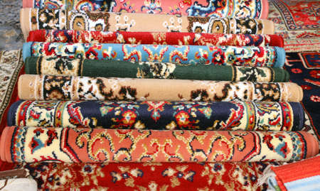 wool rugs: precious ancient colored wool rugs made by hand in the Middle East Stock Photo