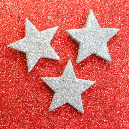 three large silver stars on red