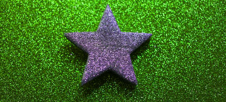 gaudy: silver five-pointed star in the green background Stock Photo