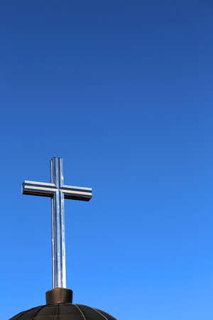 religiosity: cross symbol in transparent and deep blue sky