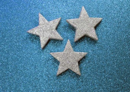 shimmering: three big stars on bright glittery background Stock Photo