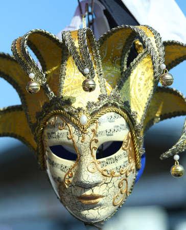 festivities: Venice Italy golden carnival mask during festivities