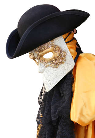 nobleman: Venice Italy, yellow carnival costume of an ancient nobleman Venetian with decorated mask and black hat Stock Photo