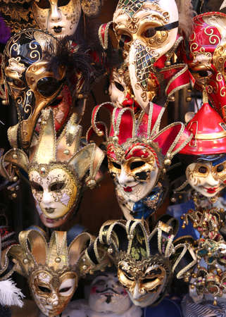 venice carnival: Venice Italy, red and golden carnival mask for sale in the shop