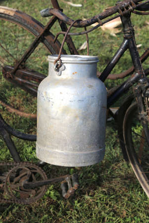 milkman: old aluminum milk churn used by farmers to bring fresh milk from the dairy barn