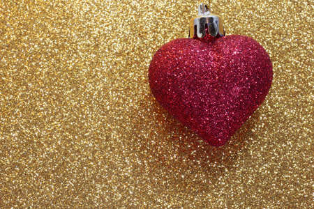 luster: shiny red heart on golden background shining