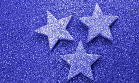 red glittery: three silver stars on bright red glittery background
