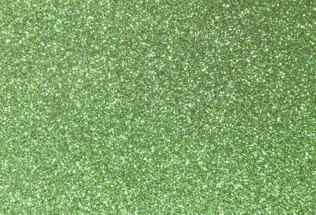 gaudy: golden background shining uniformly colored light green glitter