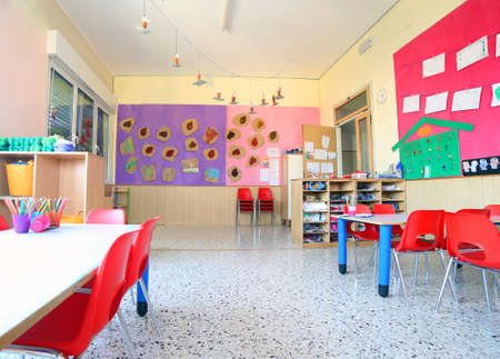 inside of the kindergarten classroom with drawings on the walls