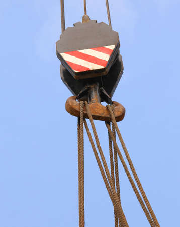 loads: huge pulley with sturdy steel cables during loading