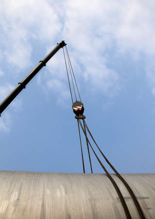 loads: big pulley with steel cables to lift heavy loads Stock Photo